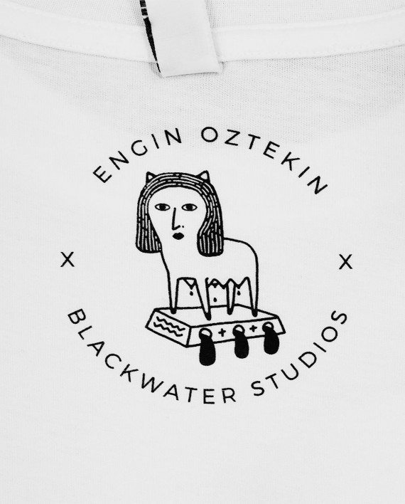 Screen printed inside neck print with art by Engin Oztekin