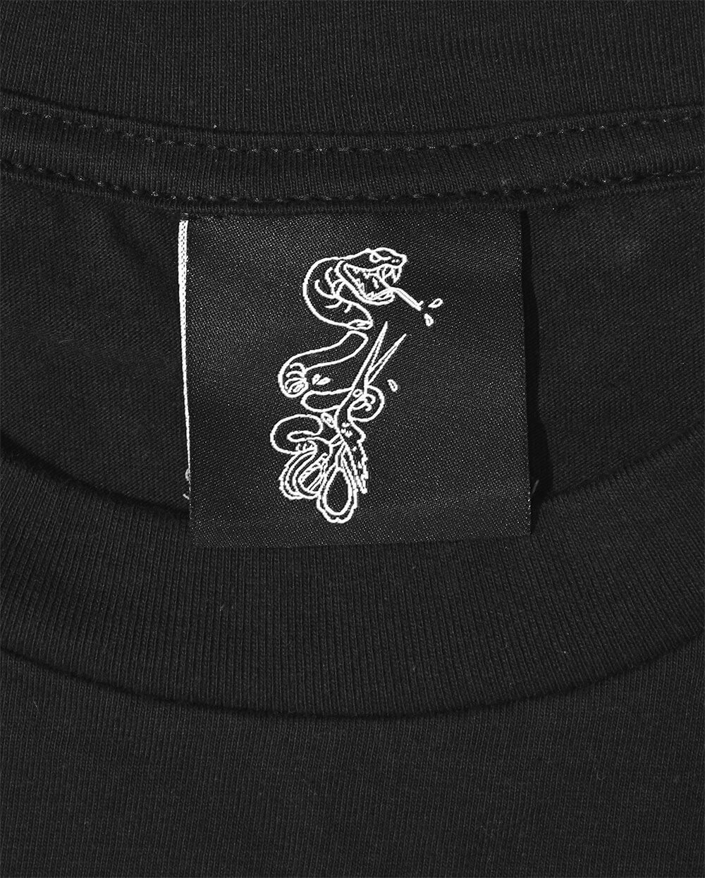 Woven Inside Neck Label of Snake on Black T Shirt